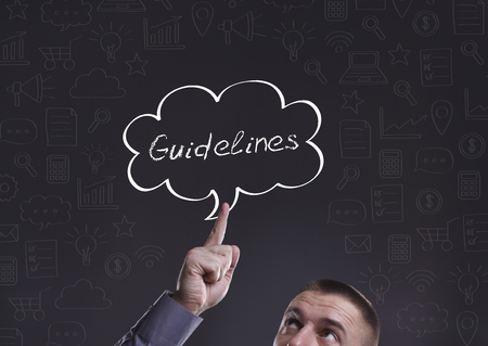 guidelines: Business, Technology, Internet and marketing. Young businessman thinking about: Guidelines