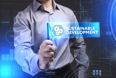 desarrollo sostenible: Business, Technology, Internet and network concept. Young businessman showing a word in a virtual tablet of the future: Sustainable development