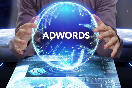 adwords: Business, Technology, Internet and network concept. Young businessman shows the word on the virtual display of the future: AdWords Stock Photo