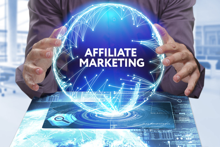Business, Technology, Internet and network concept. Young businessman shows the word on the virtual display of the future: Affiliate marketing
