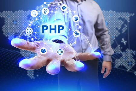 Business, Technology, Internet and network concept. Young businessman shows the word on the virtual display of the future: PHP Stock Photo
