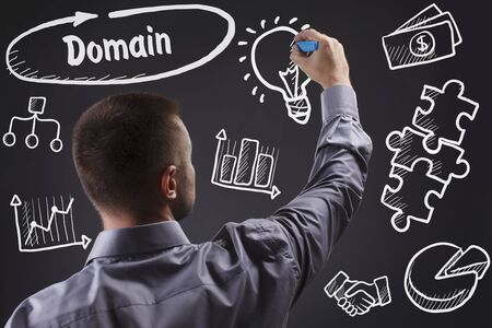 domains: Technology, internet, business and marketing. Young business man writing word: Domain Stock Photo