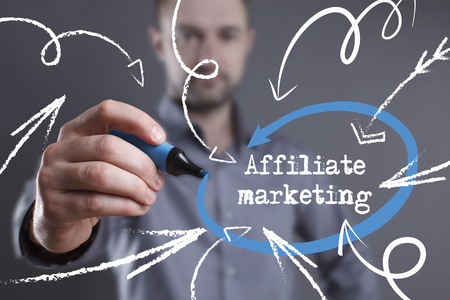 affiliate marketing: Technology, internet, business and marketing. Young business man writing word: Affiliate marketing
