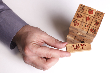 Business, Technology, Internet and network concept. Young businessman shows the word: Internal audit Stock Photo
