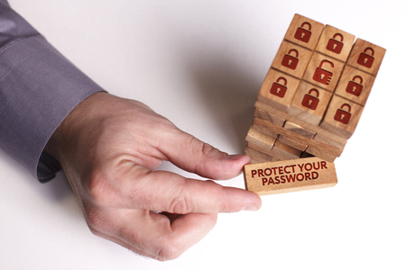 Business, Technology, Internet and network concept. Young businessman shows the word: Protect your password 스톡 콘텐츠