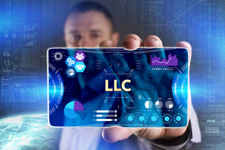 Business, Technology, Internet and network concept. Young businessman showing a word in a virtual tablet of the future: LLC