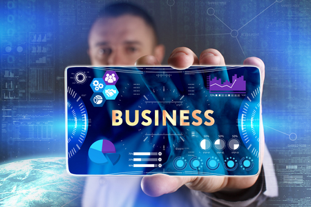 Business, Technology, Internet and network concept. Young businessman showing a word in a virtual tablet of the future: Business