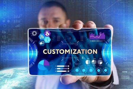 Business, Technology, Internet and network concept. Young businessman showing a word in a virtual tablet of the future: Customization Stock Photo