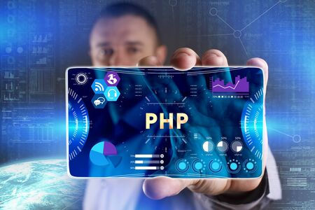 Business, Technology, Internet and network concept. Young businessman showing a word in a virtual tablet of the future: PHP