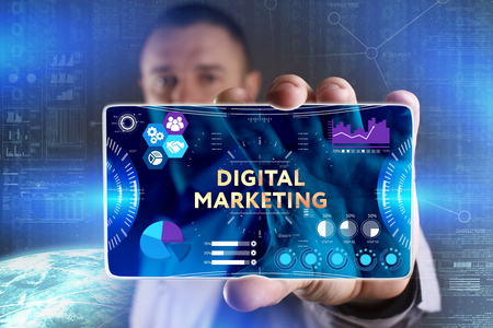 Business, Technology, Internet and network concept. Young businessman showing a word in a virtual tablet of the future: Digital Marketing Stock Photo