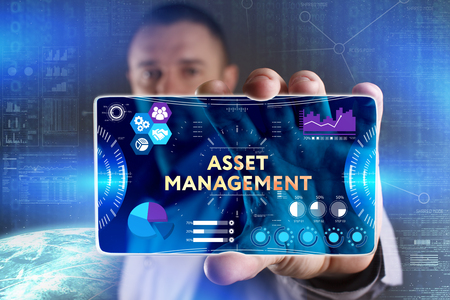digital asset management: Business, Technology, Internet and network concept. Young businessman showing a word in a virtual tablet of the future: Asset management Stock Photo