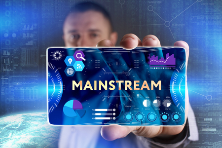 Business, Technology, Internet and network concept. Young businessman showing a word in a virtual tablet of the future: Mainstream Stock Photo