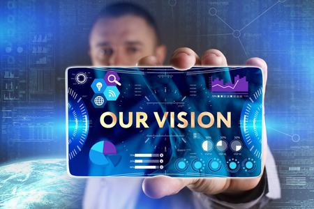 Business, Technology, Internet and network concept. Young businessman showing a word in a virtual tablet of the future: Our vision
