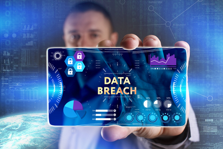 Business, Technology, Internet and network concept. Young businessman showing a word in a virtual tablet of the future: Data breach Stock Photo