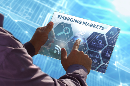 emerging markets: Business, Technology, Internet and network concept . Young business man working on the tablet of the future , select the virtual screen: Emerging markets Stock Photo