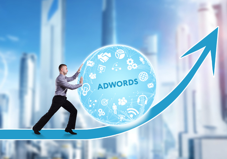 adwords: Technology, the Internet, business and network concept. A young businessman overcomes an obstacle to success: AdWords