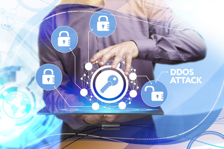 control fraud: Business, Technology, Internet and network concept. Young businessman working on a virtual screen of the future and sees the inscription: Ddos attack Stock Photo