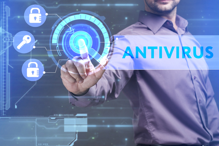 control fraud: Business, Technology, Internet and network concept. Young businessman working on a virtual screen of the future and sees the inscription: Antivirus Stock Photo