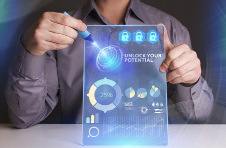 control fraud: Business, Technology, Internet and network concept. Young businessman working on a virtual screen of the future and sees the inscription: Unlock your potential