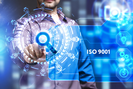 creating: Business, Technology, Internet and network concept. Young businessman working on a virtual screen of the future and sees the inscription: ISO 9001