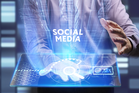 Business, Technology, Internet and network concept. Young businessman working on a virtual screen of the future and sees the inscription: Social media Stock Photo