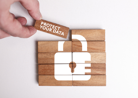 Business, Technology, Internet and network concept. Young businessman shows the word: Protect your data