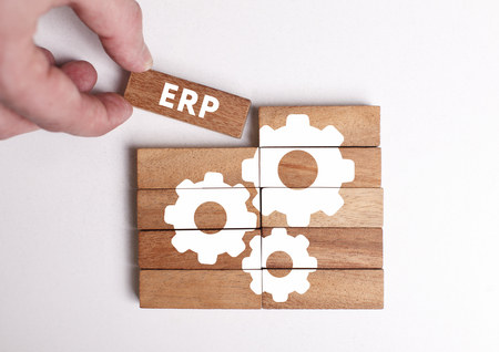 Business, Technology, Internet and network concept. Young businessman shows the word: ERP Stock Photo