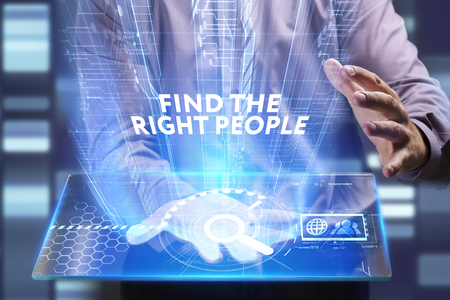 Business, Technology, Internet and network concept. Young businessman working on a virtual screen of the future and sees the inscription: Find the right people Stock Photo