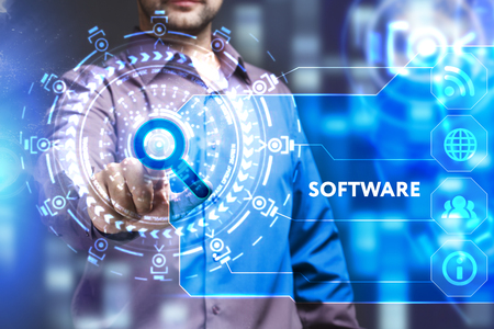 Business, Technology, Internet and network concept. Young businessman working on a virtual screen of the future and sees the inscription: Software Stock Photo