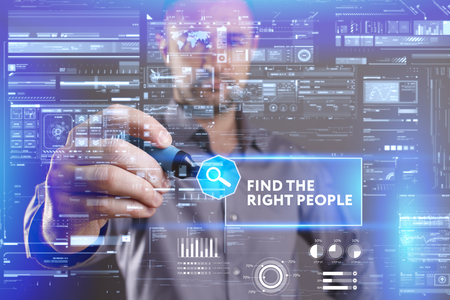 keyword: Business, Technology, Internet and network concept. Young businessman working on a virtual screen of the future and sees the inscription: Find the right people Stock Photo