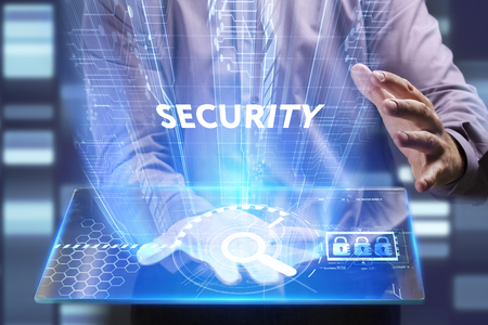 Business, Technology, Internet and network concept. Young businessman working on a virtual screen of the future and sees the inscription: Security Stock Photo
