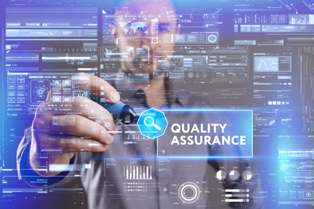 keyword: Business, Technology, Internet and network concept. Young businessman working on a virtual screen of the future and sees the inscription: Quality assurance Stock Photo