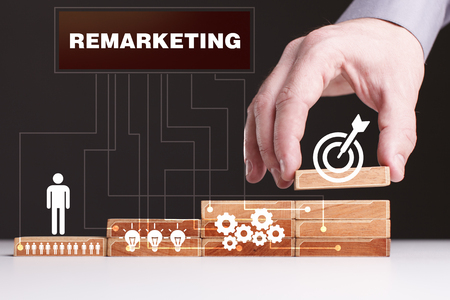 The concept of technology, the Internet and the network. Businessman shows a working model of business: Remarketing