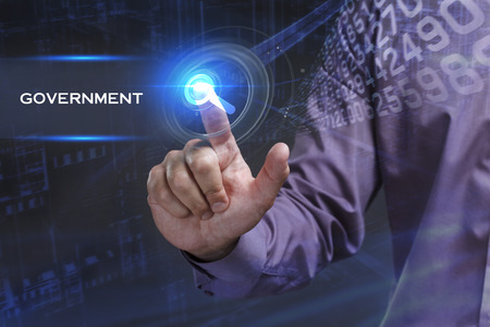 keyword: Business, Technology, Internet and network concept. Young businessman working on a virtual screen of the future and sees the inscription: Government