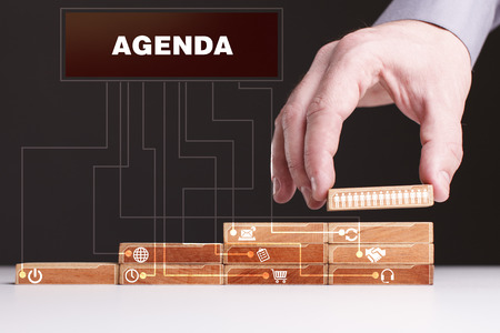 keyword: The concept of technology, the Internet and the network. Businessman shows a working model of business: Agenda