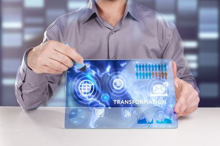 keyword: Business, Technology, Internet and network concept. Young businessman working on a virtual screen of the future and sees the inscription: Transformation