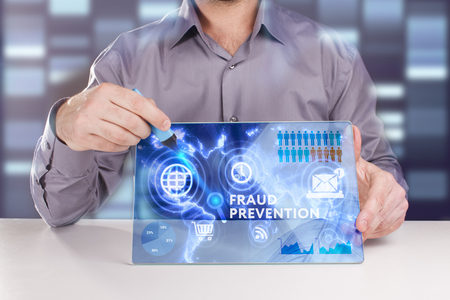 keyword: Business, Technology, Internet and network concept. Young businessman working on a virtual screen of the future and sees the inscription: Fraud prevention