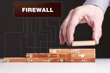 The concept of technology, the Internet and the network. Businessman shows a working model of business: Firewall
