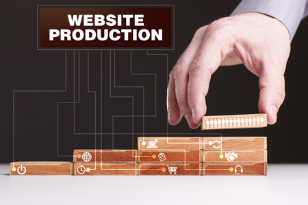 The concept of technology, the Internet and the network. Businessman shows a working model of business: Website production