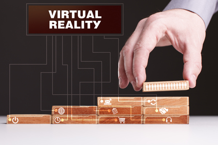 The concept of technology, the Internet and the network. Businessman shows a working model of business: Virtual reality Stock Photo