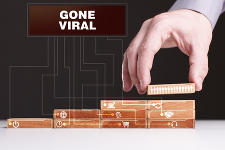 The concept of technology, the Internet and the network. Businessman shows a working model of business: Gone viral