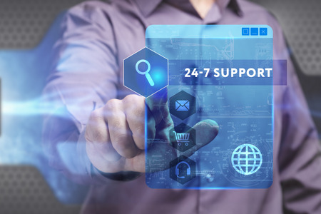 keyword: Business, Technology, Internet and network concept. Young businessman working on a virtual screen of the future and sees the inscription: 24-7 Support