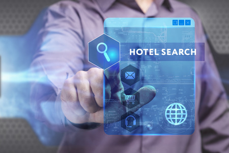 keyword: Business, Technology, Internet and network concept. Young businessman working on a virtual screen of the future and sees the inscription: Hotel search