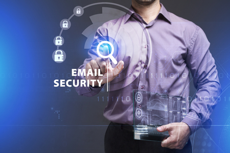 Business, Technology, Internet and network concept. Young businessman working on a virtual screen of the future and sees the inscription: Email security Imagens