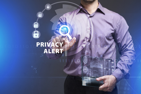swindle: Business, Technology, Internet and network concept. Young businessman working on a virtual screen of the future and sees the inscription: Privacy alert Stock Photo