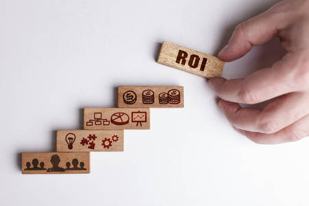 The concept of technology, the Internet and the network. Businessman shows a working model of business: ROI Stock Photo