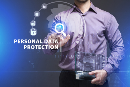 swindle: Business, Technology, Internet and network concept. Young businessman working on a virtual screen of the future and sees the inscription: Personal data protection
