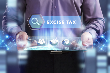 excise: Business, Technology, Internet and network concept. Young businessman working on a virtual screen of the future and sees the inscription: Excise tax Stock Photo