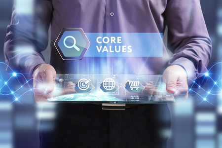 core strategy: Business, Technology, Internet and network concept. Young businessman working on a virtual screen of the future and sees the inscription: Core values