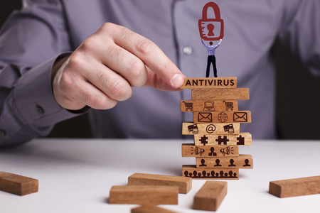 The concept of technology, the Internet and the network. Businessman shows a working model of business: Antivirus Stock Photo